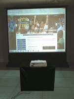 Projection screen and projector in office setting