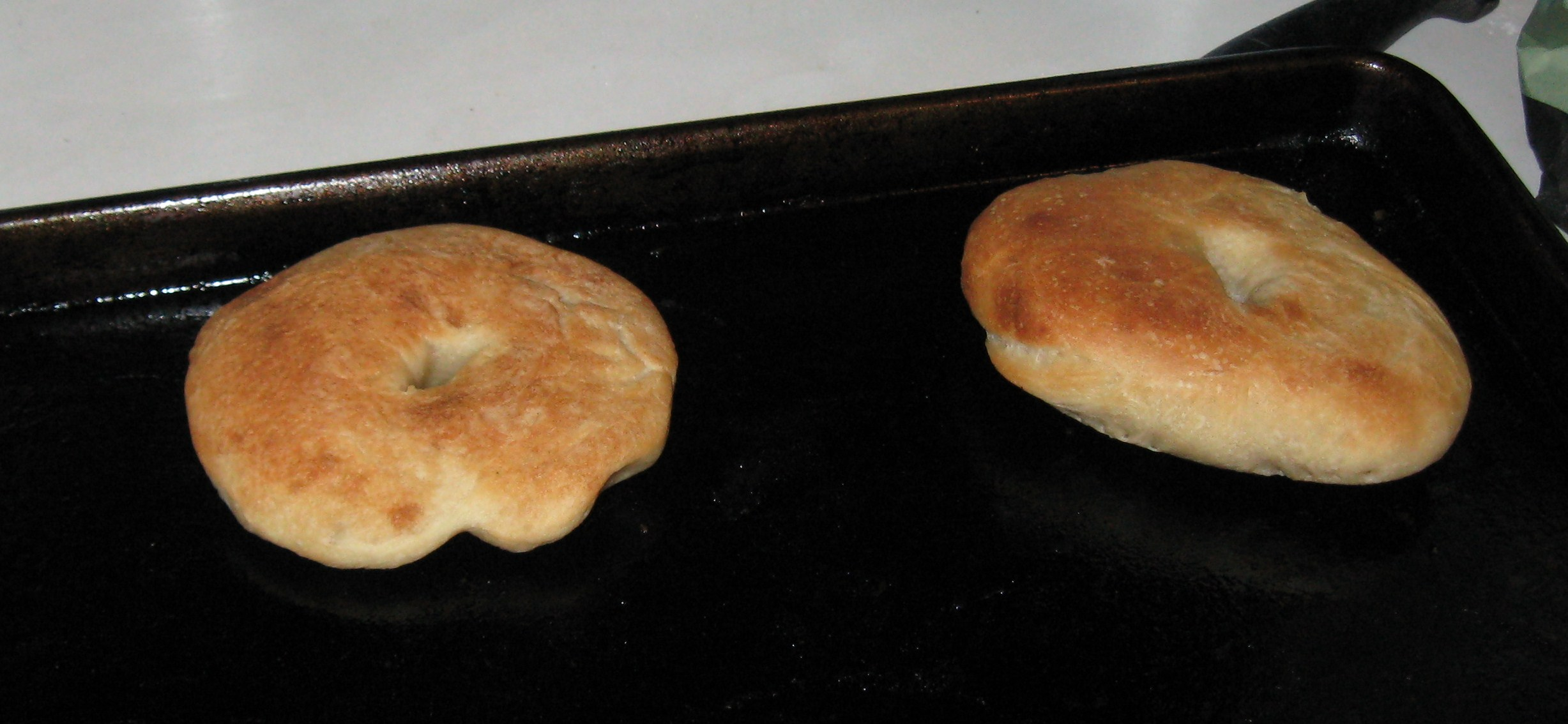 there were two little bagels, sitting on the tray...