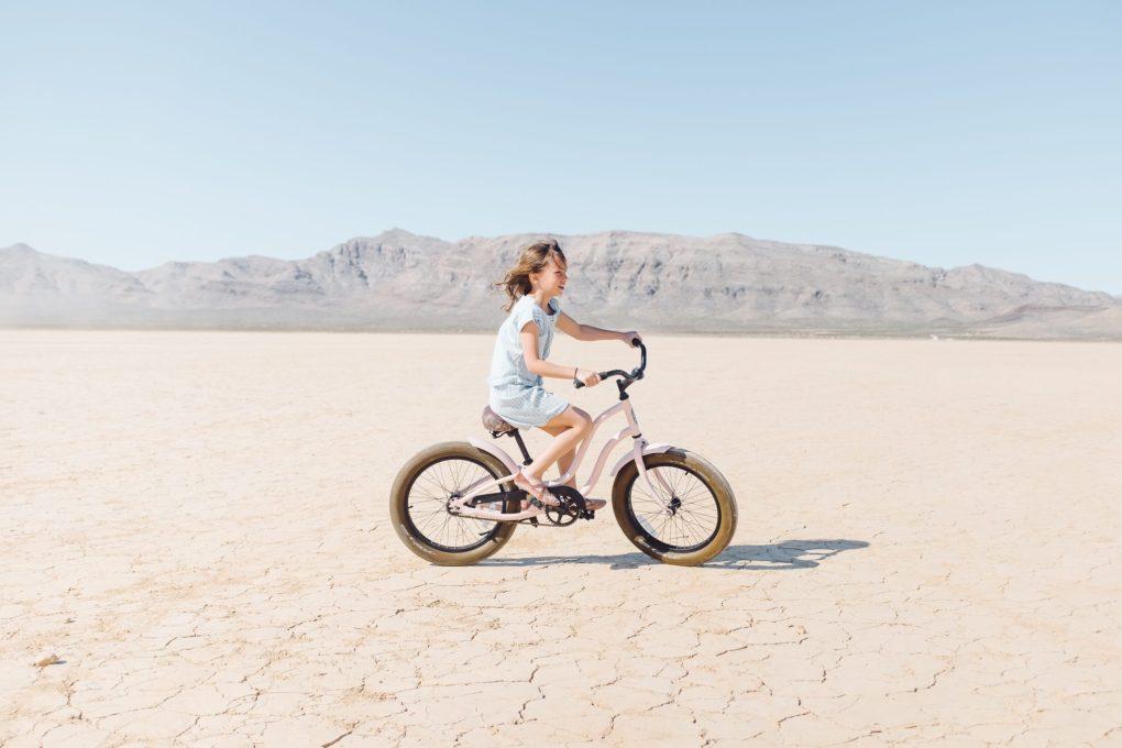 dry january benefits, girl riding bike in desert