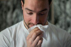 best telemedicine apps, man blowing nose