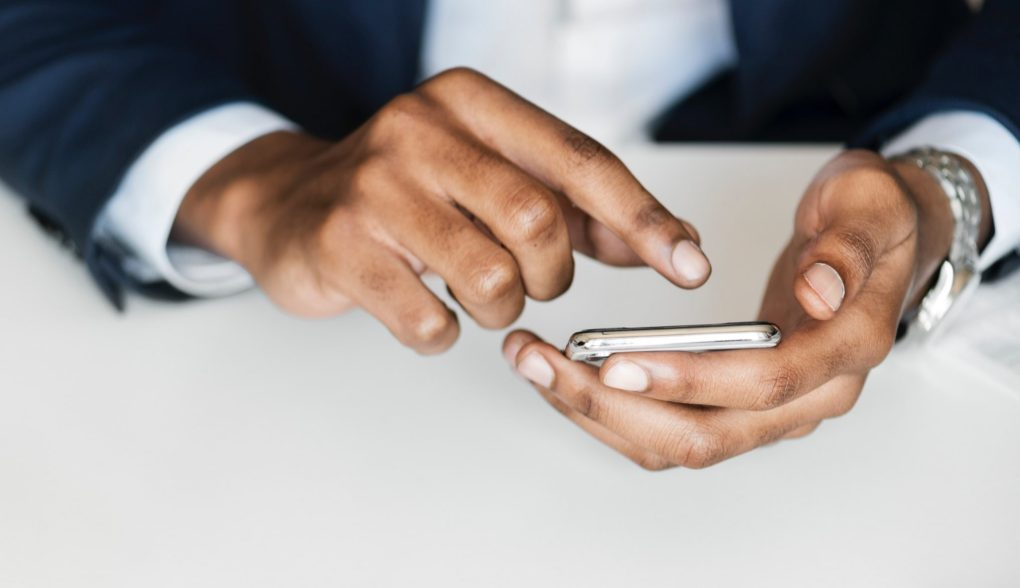 hands holding a smartphone using the Ria Health App