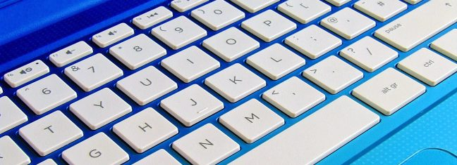 Zoomed in on a bright blue laptops white keyboard.