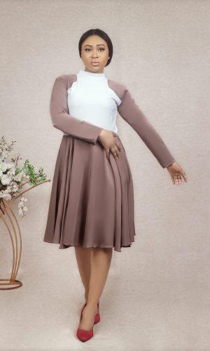 fair model wearing a rina flared dress by Ria Kosher