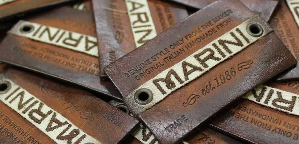 Etichette in pelle vintage, ricamate ed invecchiate.