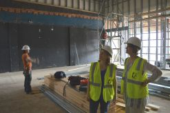 Main Street Theater staff member Shannon Emerick standing with Rebecca Udden in the new double-height auditorium.