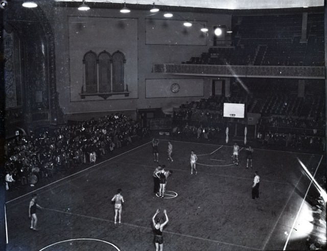 Glass basketball in auditorium c1930