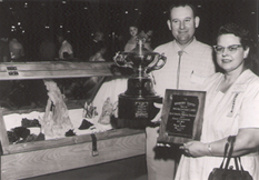 Richard and Helen Rice with awards for collections - founders of the Rice Northwest Museum of Rocks and Minerals - circa 1950s.