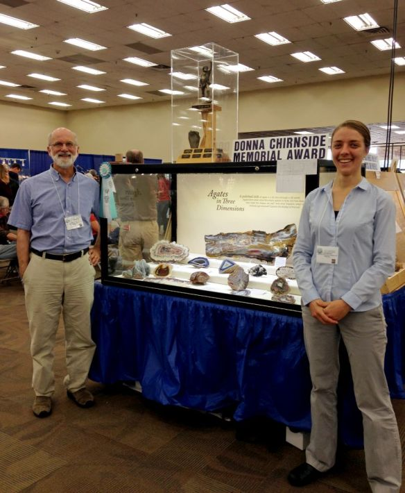 Julian Gray and Leslie Moclock with the Rice NW Museum case of agates at the 2014 Denver Gem & Mineral Show