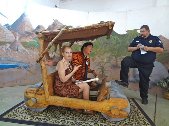Fred and Wilma Flintstone get pulled over by a cop and get a ticket at the Rice Northwest Museum of Rocks and Minerals