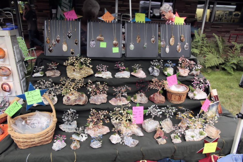 Jewelry and gem trees for sale at vendor booth.