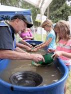 Gold panning with rock club members and children.