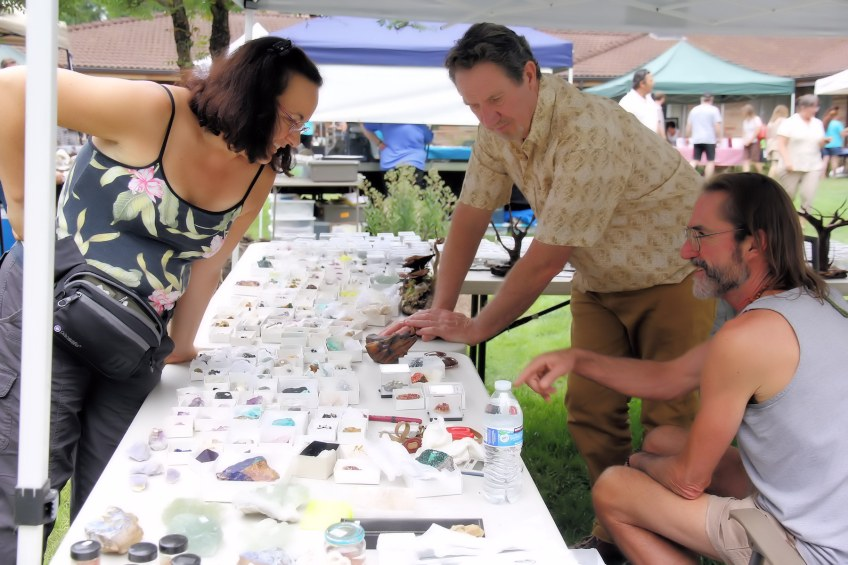 Shopping at a jewelry vendor booth with precious minerals.