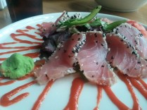 Ahi Tuna, served barely-seared, with soy sauce and wasabi.