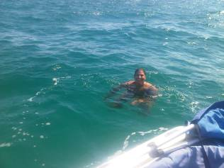 Andrea swimming with sharks
