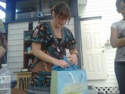 Tina opening gifts