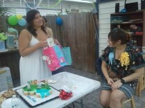 Tina opening gifts for baby