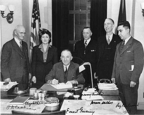 The Governor Signs the bill, 1945.