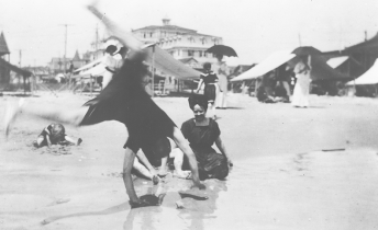 A family vacation in Atlantic City in 1905. Ford has every reason to turn a cartwheel: he is forty-five now and his company is thriving. His wife, Clara, sits beside him while their son, Edsel, digs in the sand.