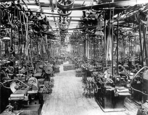 """The tools that made them. This is the machine shop at Highland Park. When it was going full tilt, it horrified one visiting journalist, who wrote that the racket t made was like that of """"...a million monkeys quarreling, a million lions roaring, a million pigs dying, a million elephants smashing through a forest of sheet iron...[and] a million sinners groaning as they are dragged off to hell."""""""