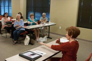 Sheila Johnstone instructs American Sign Language Advanced Class.