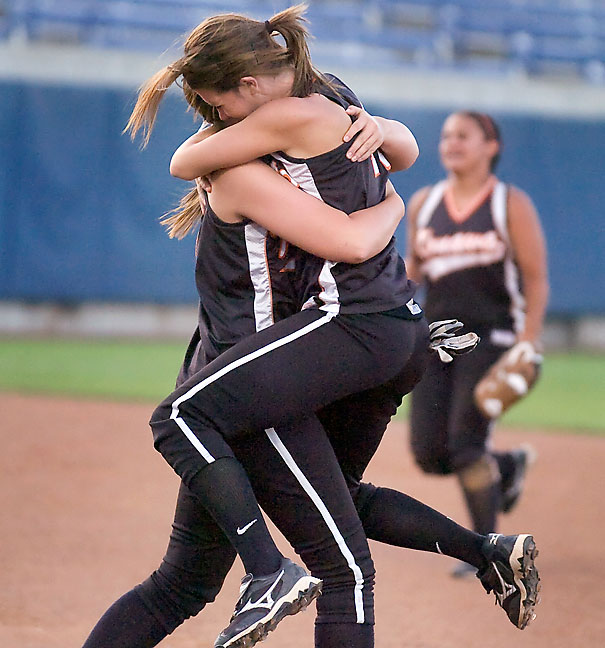 Moments earlier, those same softball players won a state championship game, as illustrated by this image.