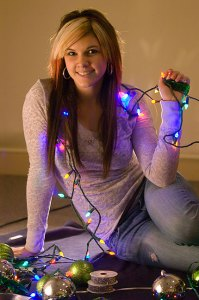 Devon Liljequist poses with some Christmas lights; she is a part time model.