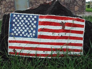 Abby's image of a U. S. flag painted on a boulder at Veteran's Park in Coalgate, Oklahoma, August 2003.