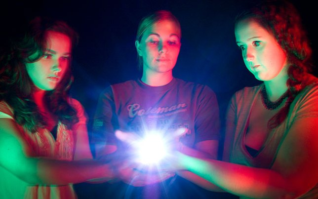 Darkened studio + three colored flashlights + cooperative models, assistants and fellow photographers = a fun learning experience for all of us.