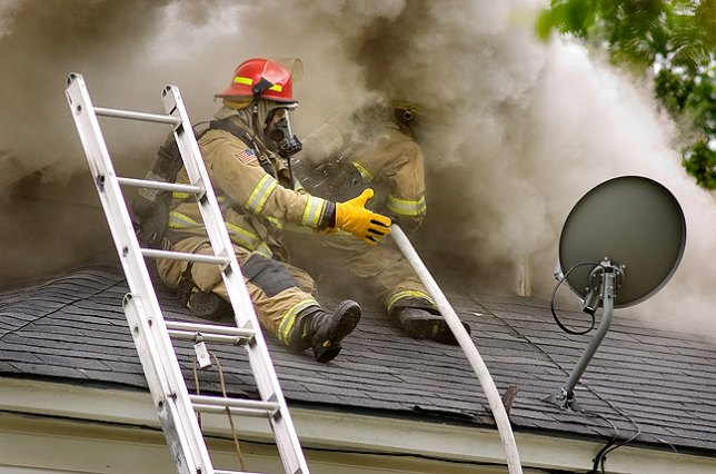 Ada firefighters work to extinguish a blaze, 2011