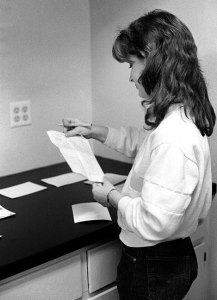 A young journalism student named Darlene works on an assignment in the darkroom at Copeland Hall. She had penetratingly dark, beautiful eyes, and came to my house to let me photograph her.