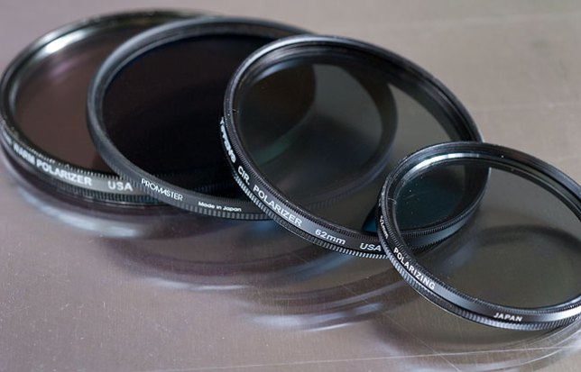 Over the years I have collected a number of polarizers, but you really only need one, big enough for your biggest diameter lens (in my case, 77mm) and a step-up ring which will allow you to put bigger filters on smaller lenses.