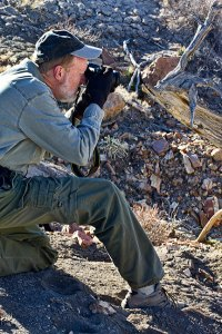 Greg Smith made this image of me shooting with the AF-S Nikkor 18-200mm f/3.5-5.6 at the Penistaja Badlands in northwestern New Mexico last month. I was very pleased with the result.
