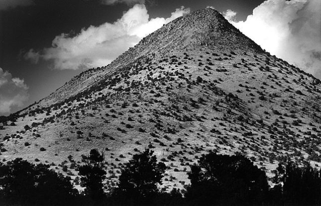 Tres Montosas, a peak on U.S. 60 near Magdalena, New Mexico, September 2000; this image was made with a red filter on a 135mm f/3.5 Nikkor of 1978 vintage.