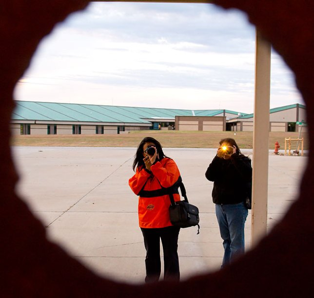 They photographed me photographing them through a practice welding hole.