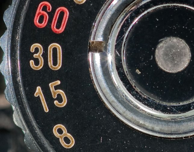This close-up of a Minolta shutter speed dial is a 100% pixel view right out of the camera with no unsharp mask applied. Compare it to...