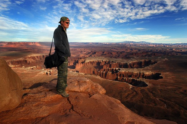 The author stands at the edge of a 1200-foot cliff face at Grand View Point in the Island in the Sky District of Canyonlands National Park, Utah in April 2011.