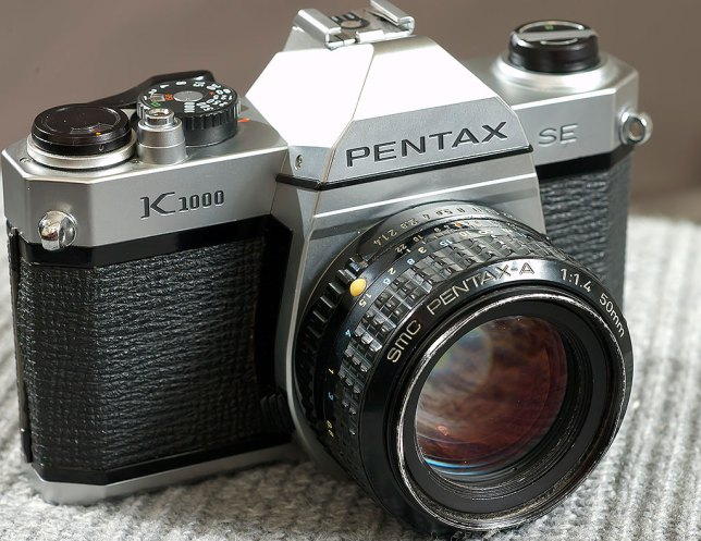 There are few cameras as straightforward and fundamental as the venerable Pentax K-1000. This one was used for many years by reporters at my newspaper before being retired to the downstairs display case. It works perfectly to this day.