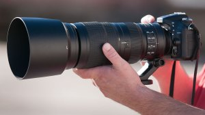 A co-worker of mine has Nikon's newest 200-500mm f/5.6 lens, which could fill up the frame with an eclipse pretty effectively at 500mm.