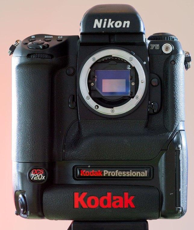 The Kodak DCS 720x stands tall on its Kodak digital section. It's battery weighs more than a modern smartphone.