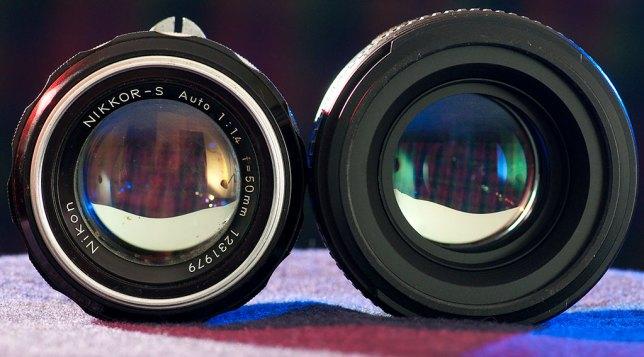 The Nikkor-S 50mm f/1.4 sits next to the new AF-S Nikkor 50mm f/1.4.