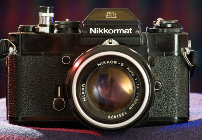 My all-metal, tough-as-nails Nikkormat EL sits in my studio. It is heavy, blocky, and reliable.