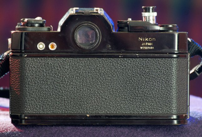 In the 21st century, it's weirdly unsettling to look at the back of a camera and not see a monitor. Pushing the white button on the back of the Nikkormat EL lit up the orange button, indicating the state of the battery.
