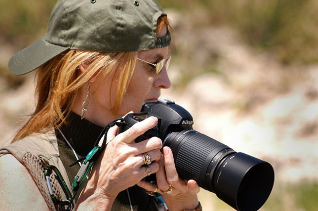 Abby uses her D70S with the lightweight 75-300mm f/4-5.6G at Scott's Bluff National Monument in July 2005.