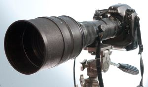 As formidable as this combination of the Nikkor 400mm f/3.5 and its TC-14 teleconverter looks, it's still not really long enough for photographing objects the size of the sun and moon.