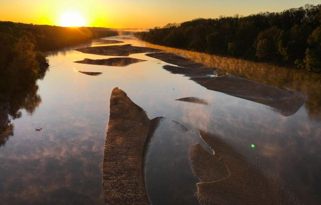 The sun rises over the Canadian River north of Byng. This image was made with a wide angle lens.
