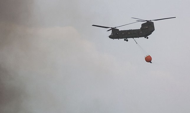 This Chinook helicopter was summoned from Oklahoma City to fight the Happyland fire, only to be diverted to the Byng fire.