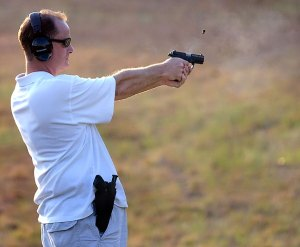 Pete sends a .380 downrange during our time at the pond this evening. (Photo by Avery Haydu.)