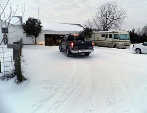 Abby arrives at home in her 4x4 Nissan pickup on one of the coldest nights either of us can remember.