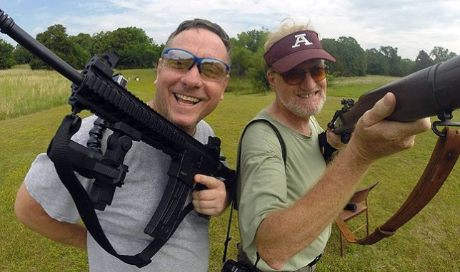Scott Andersen, left, and I pose for a photo at my shooting range yesterday morning. I am holding a Springfield 03a3, and Scott has my Smith and Wesson M&P 15/22, which he decided, correctly, is the most fun firearm ever made.