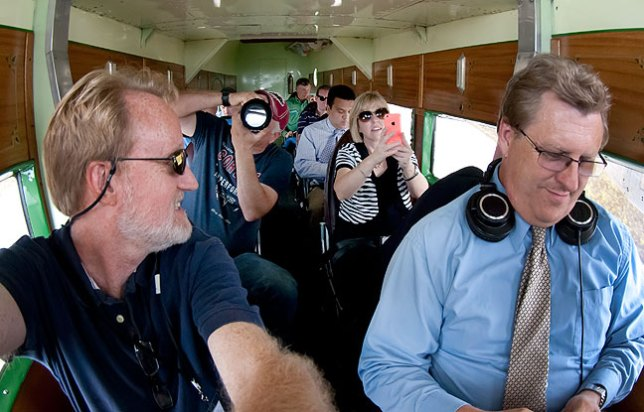 In the front two rows of the Tri-Motor with me (left) are Explore Ada videographer Will Boggs, City of Ada spokesperson Lisa Bratcher, and KCNP radio journalist Brian Brasier, all longtime friends.
